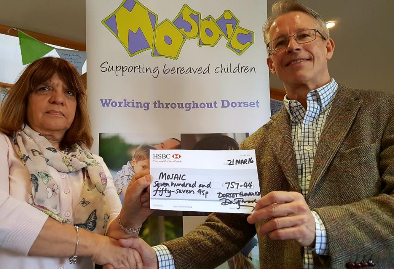 David Warden presenting a cheque to the Mosaic charity for bereaved children in Dorset.